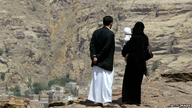 Yemeni couple holding child