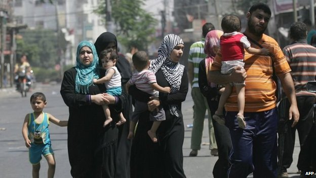 "Palestinians leave their neighbourhood to head to a safer location as Israel""s army continued to shell the area of Rafah"