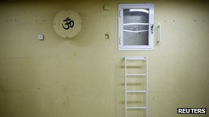 A wall with a painted sign is seen in a bomb shelter in the Israeli southern city of Ashkelon July 31