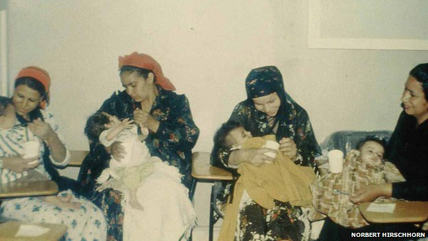 Mothers feeding babies