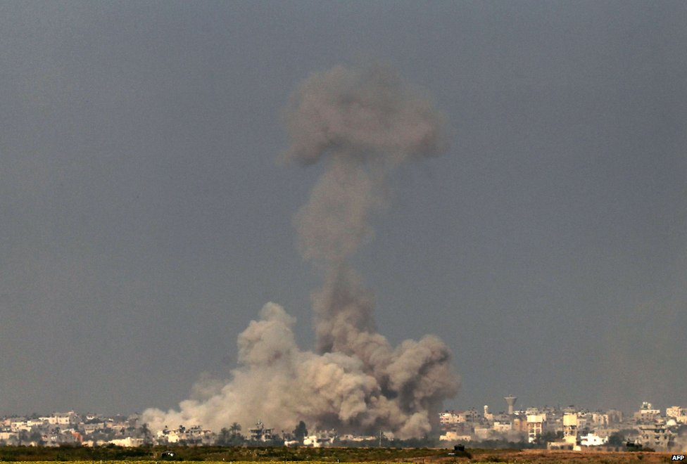 Israel-Gaza border, smoke rises from the coastal side of the Gaza Strip following an Israeli controlled explosion of a tunnel