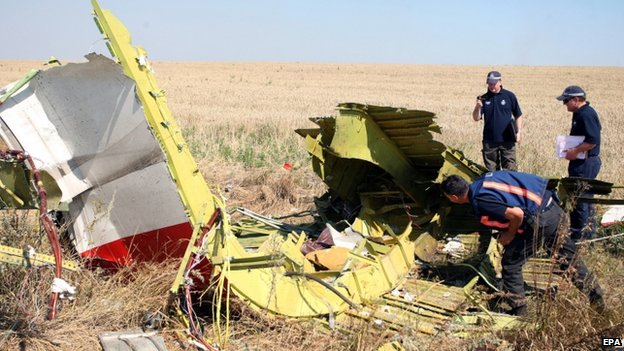 Australian and Dutch investigators examine a piece of debris from the Malaysia Airlines Flight MH17 plane, near the village of Hrabove, 100km from Donetsk, eastern Ukraine (1 August 20014)
