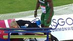 Nigerian triple jumper Olumide Olamgoke collides with an official at the 2014 Commonwealth Games in Glasgow