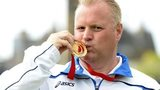 Darren Burnett kisses his gold medal