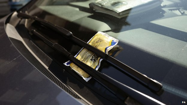 A parking ticket on a car