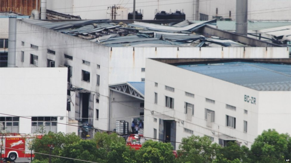This photo released by China's Xinhua News Agency shows the damaged workshop, 2 Aug
