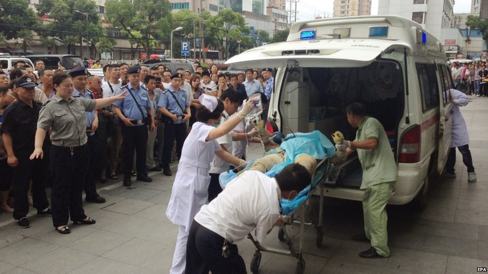 Injured person put aboard an ambulance, 2 Aug
