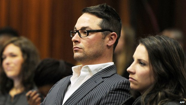"""Carl Pistorius (2nd R) and Aimee Pistorius (R), the siblings of South African paralympian Oscar Pistorius, sit at the High Court in Pretoria during Oscar Pistorius"""" trial on July 2, 2014"""