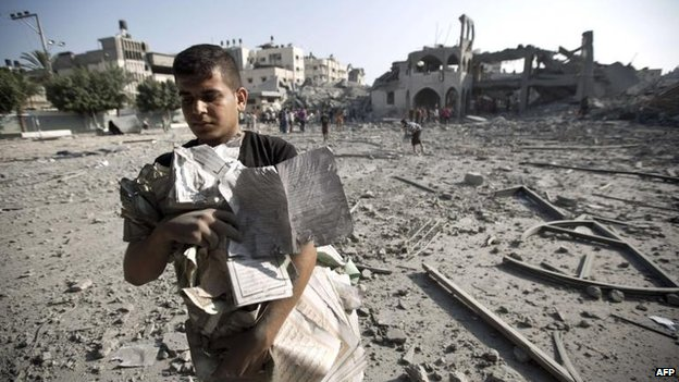 Copies of the Koran are removed from a destroyed mosque in Gaza City, 2 Aug