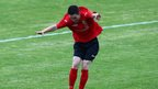 County Antrim's Paul Smyth prepares to celebrate his winning goal against County Down in the Premier category