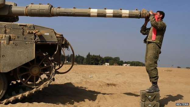 Israeli soldier checks tank near Gaza border - 2 August