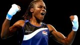 Nicola Adams (R) of England celebrates winning the gold medal against Michaela Walsh of Northern Ireland