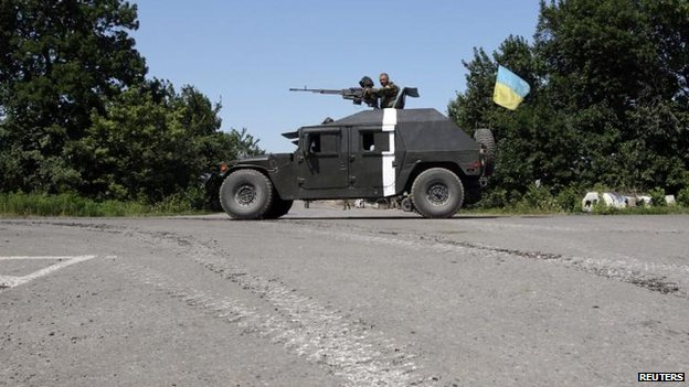 Ukrainian forces outside the eastern Ukrainian village of Nikishyne, Donetsk region, 1 Aug