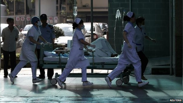 A victim is rushed to hospital in Kunshan, 2 Aug