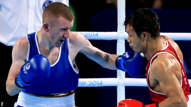 Paddy Barnes lands a left hand on India's Devendro Laishram