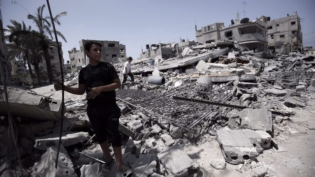 A Palestinian inspects the rubble of a destroyed house of Al-Neirab family after Israeli air strikes in the south of Gaza City, 02 Augast 2014