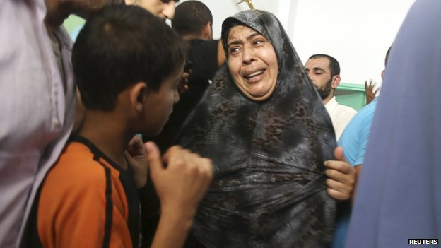 Palestinians at Rafah hospital mourn child said to have been killed in Israeli air strike