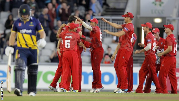 Lancashire celebrate one of Jordan Clark's wickets