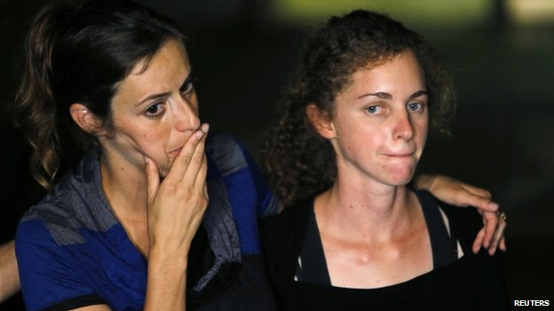Hadar Goldin's sister and fiancee at a news conference - 2 August