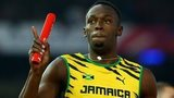Usain Bolt of Jamaica holds off England's Danny Talbot