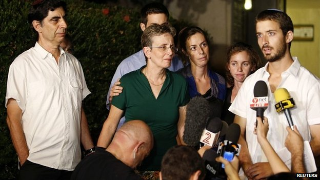 Family members of Hadar Goldin at a news conference outside their house in Kfar Saba - 2 August 2014