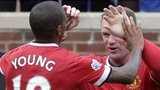 Ashley Young celebrates scoring with Wayne Rooney