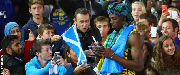 Usain Bolt of Jamaica greets fans as he celebrates winning gold in the men''s 4x100 metres relay final at Hampden Park
