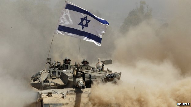 Israeli soldiers ride a tank after returning to Israel from Gaza
