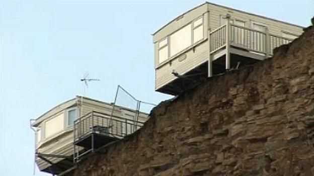Caravans on edge of cliff