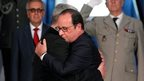 French President Francois Hollande and his German counterpart Joachim Gauck embrace during a commemoration ceremony at the WWI Hartmannswillerkopf National Monument, or Vieil Armand, in Wattwiller, north-eastern France