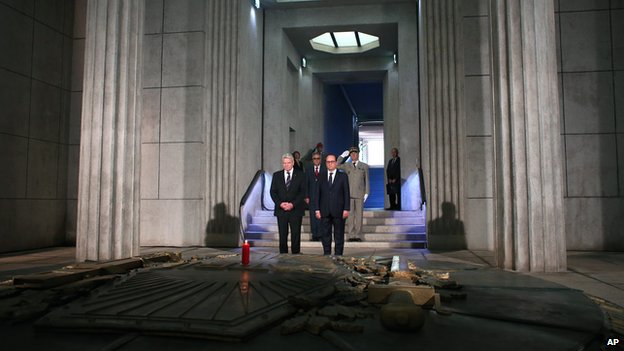 President Francois Hollande stands next to German President Joachim Gauck in the crypt of the the National Monument of Hartmannswillerkop, in Wattwiller, eastern France