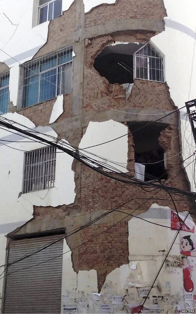 A building is damaged in Ludian county, Yunnan province
