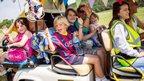 Children on a golf cart