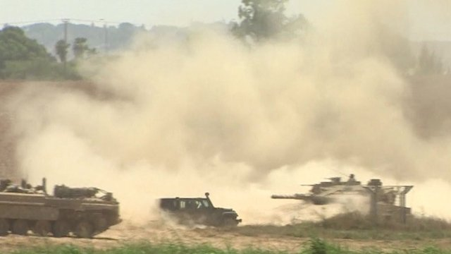 Dust flies as Israeli tanks await orders at Gaza border