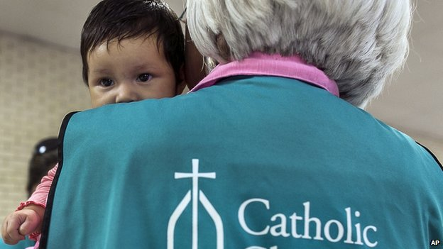 Catholic charity worker looks after El Salvador baby in Texas