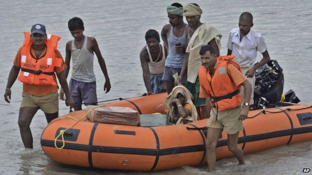 Indian rescuers move villagers living along the Kosi River to safer places in Supaul district of Bihar state, India, Sunday, Aug.3, 2014.