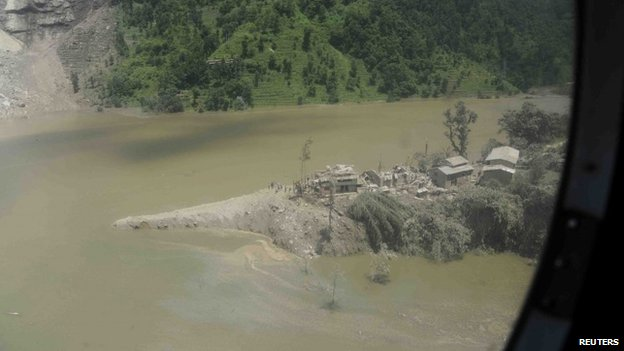 An aerial view of swollen Sunkoshi River is seen after the landslide blocked the rivers from flowing in Sindhupalchowk district in this handout picture dated August 2, 2014.