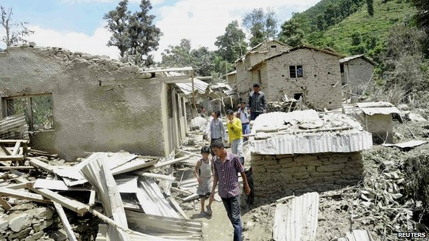 Damaged houses are pictured after the landslide in Sindhupalchowk district in this handout picture dated August 2, 2014