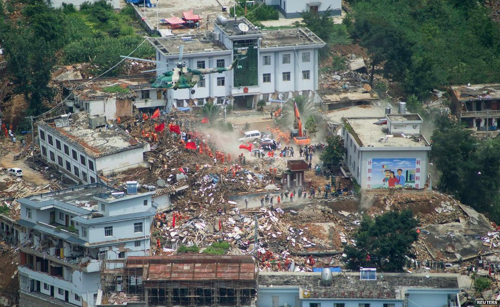 Rescue workers in Longtoushan town, Yunnan province, China