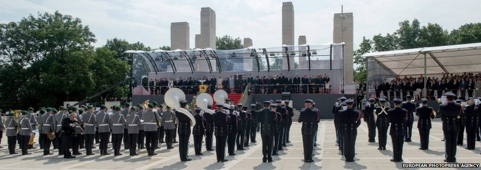 Bands from Germany, dressed in grey, and Belgium (right) performed for dignitaries attending the ceremony in Liege.