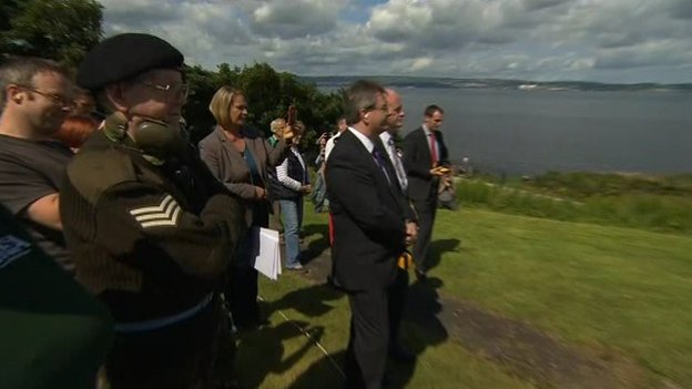 Both unionist and nationalist politicians attended the gun salute over Belfast Lough
