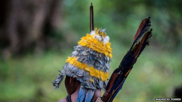 A Munduruku in feather headdress in April 2014