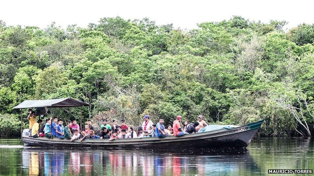 Munduruku travel on a boat in April 2014