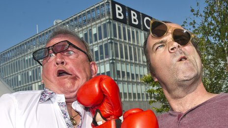 Ford Kiernan and Greg Hemphill mock up a boxing fight outside PQ