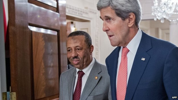 US Secretary of State John Kerry (R) walks with the Prime Minister of Libya Abdullah al-Thinni following their private bilateral meeting at the US Department of State 4 August 2014