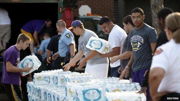 Volunteers distribute bottled water
