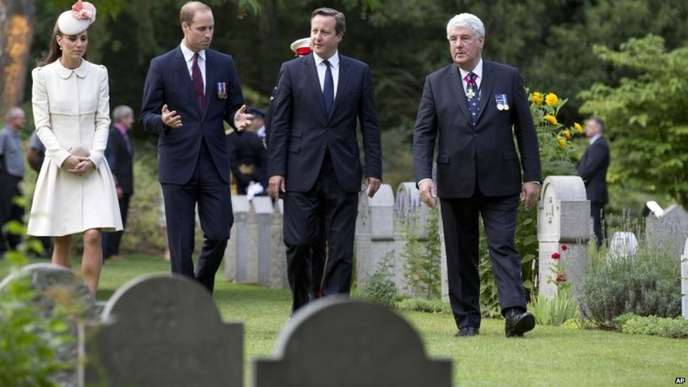 The Duke and Duchess of Cambridge and Prime Minister David Cameron arrive for a commemoration ceremony at the St Symphorien Military Cemetery in St Symphorien, Belgium