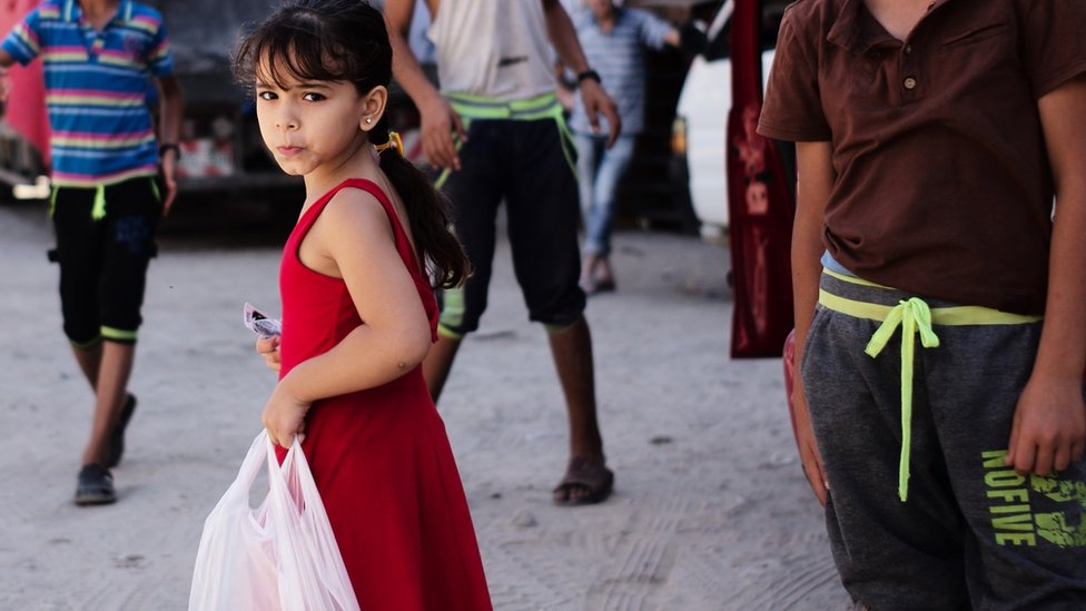 Girl with shopping in Jabalia. Aug 2014