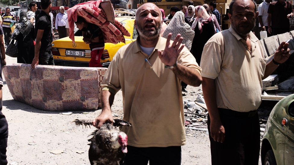 Man with duck in Beit Hanoun. Aug 2014