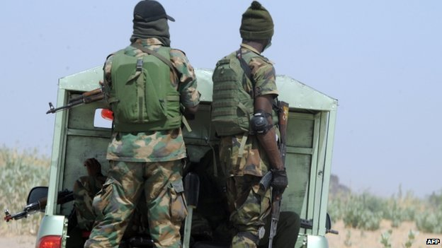 Officers of the Joint Military Task Force (JTF) patrol in the northeastern Nigerian town of Maiduguri, Borno State, on 30 April 2013.
